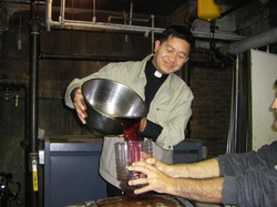 Fr Philip pouring wine.jpg