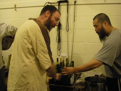 frs John Paul & Ignatius bottling.jpg