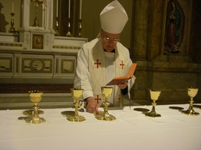 GT Walsh consecrating chalices May 14 2010.jpg