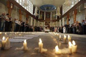 candle memorial Syrian Church.JPG
