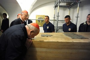 Stanislaw Dziwisz of Cracow kisses JPII coffin.jpg
