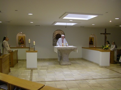 Monastery chapel, Fr Vincent Tobin OSB at Mass.jpg