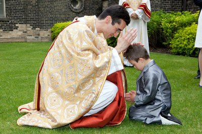 New Toronto priest blesses child May 2012.jpg