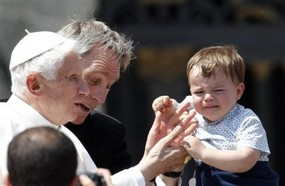cranky child and Pope May 2 2012.jpg
