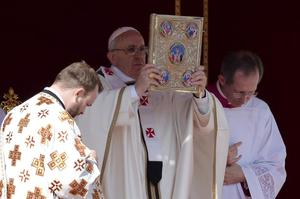 Francis blessing with evangelary.jpg