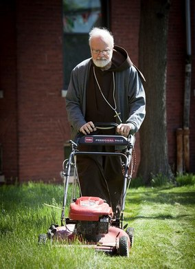 Cardinal O'Malley mowing the lawn.jpg