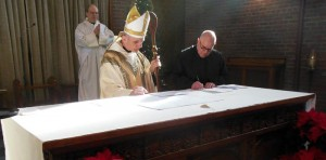 Abbot James receiving vows of Br Bernard